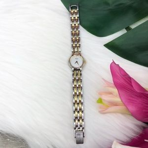 Seiko | Women's Skinny Two-Tone Round Dial Watch